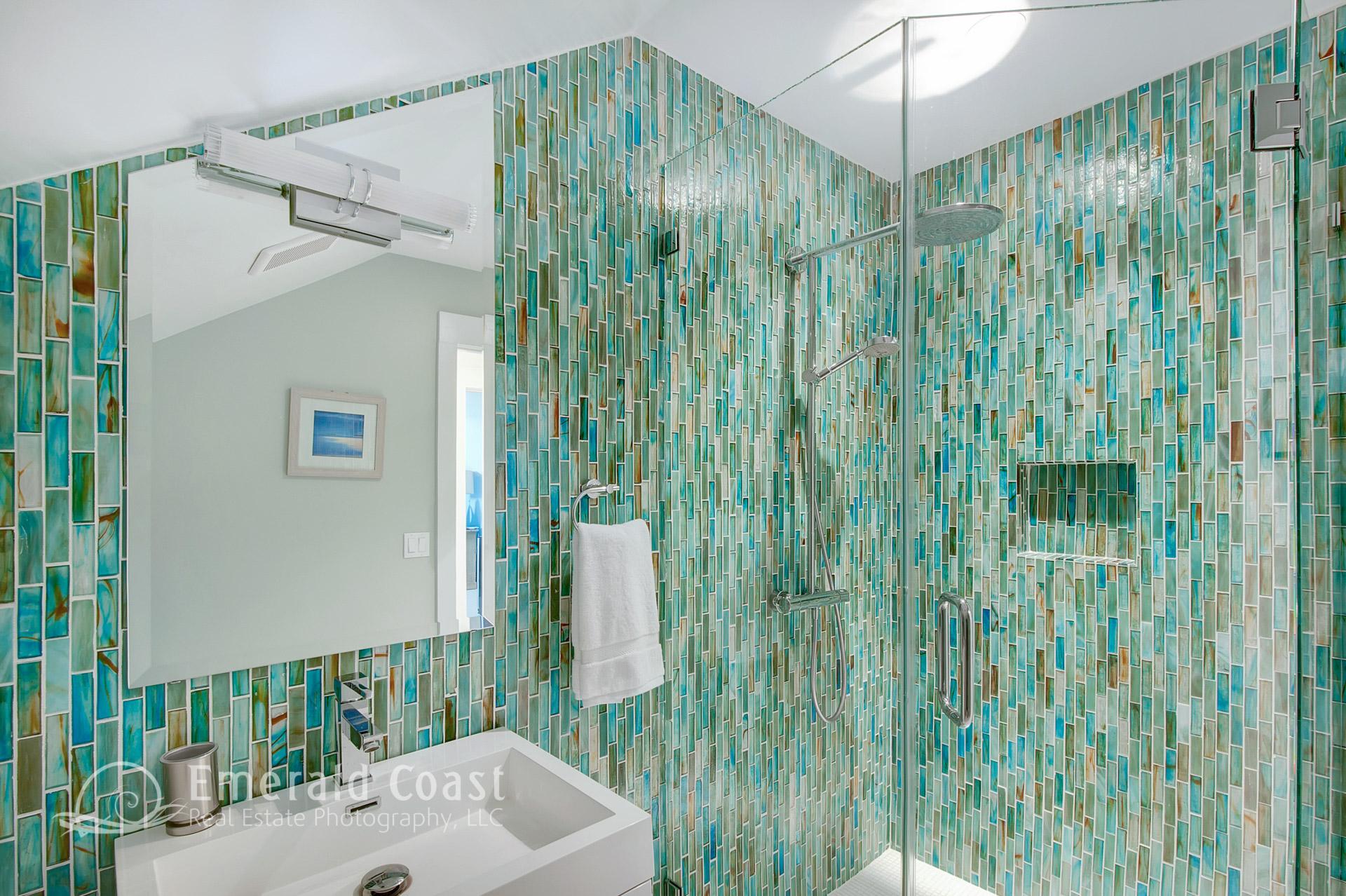 green glass tiled bathroom