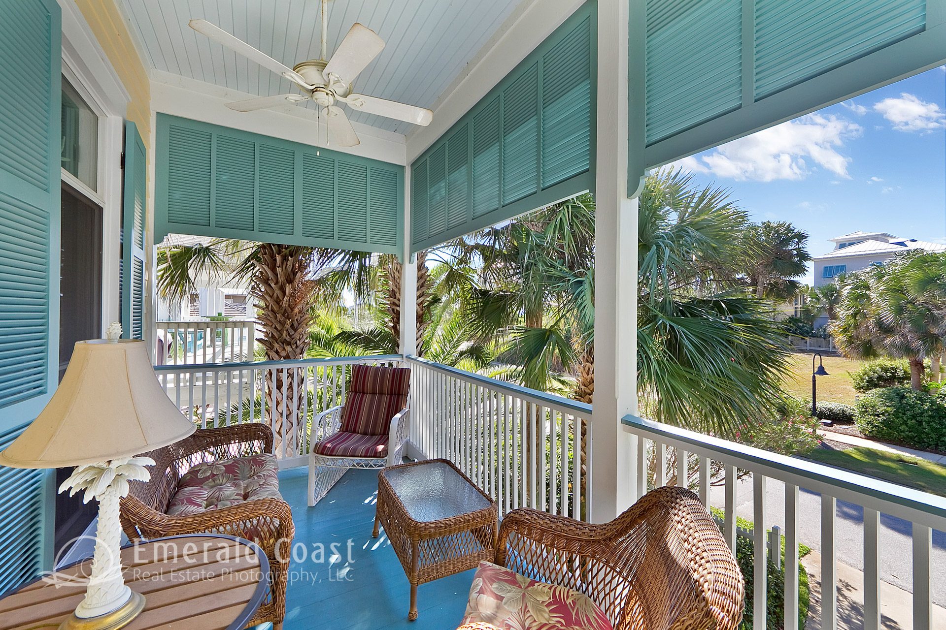 front porch with teal shutters